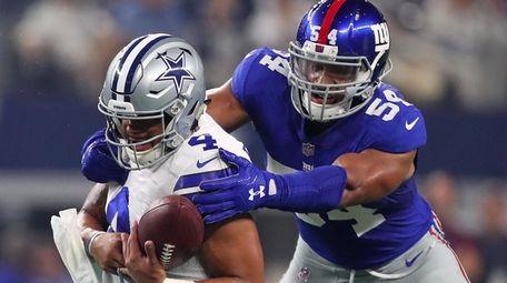 Dak Prescott of the Dallas Cowboys is sacked