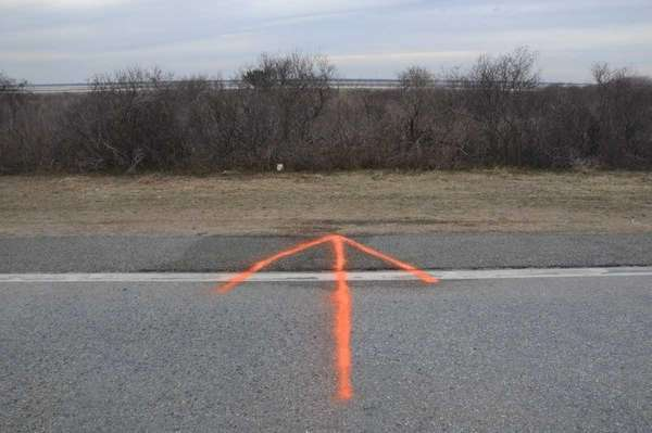 An orange arrow marks where a body was