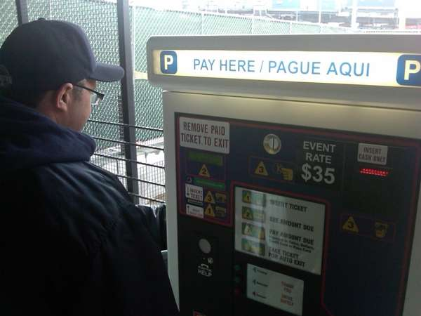A pay machine inside a parking lot at
