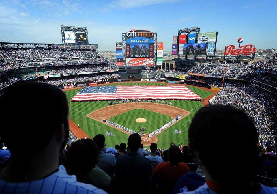 An American flag is unfurled during 2010 Opening