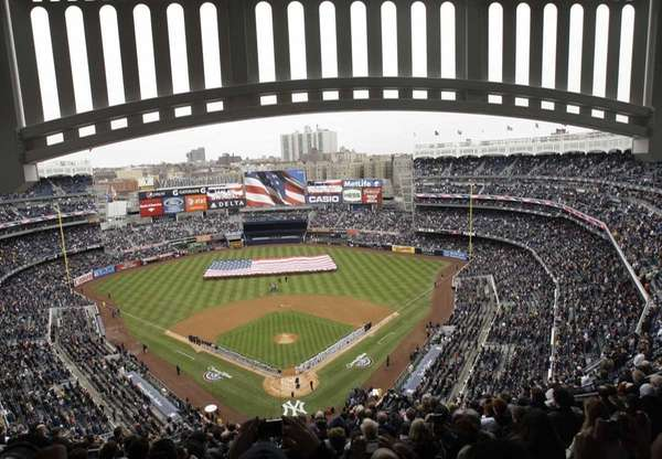Fans look on at Yankee Stadium during the