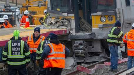 Work crews assess the damage at the Westbury