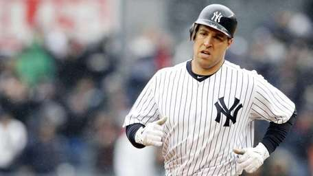 The Yankees' Mark Teixeira rounds the bases after