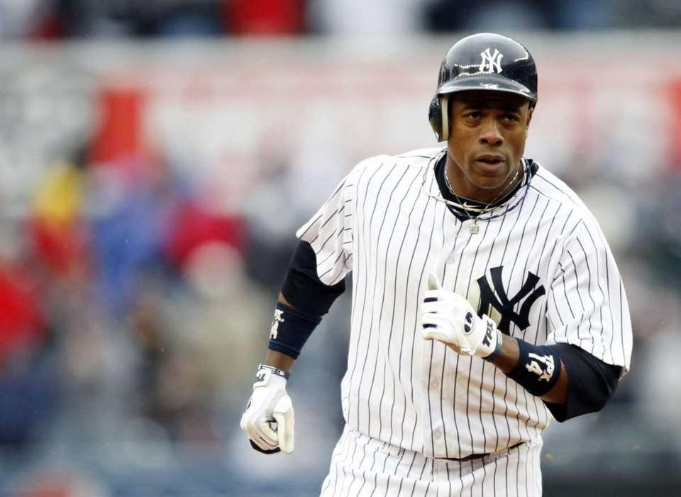 The Yankees' Curtis Granderson rounds the bases after