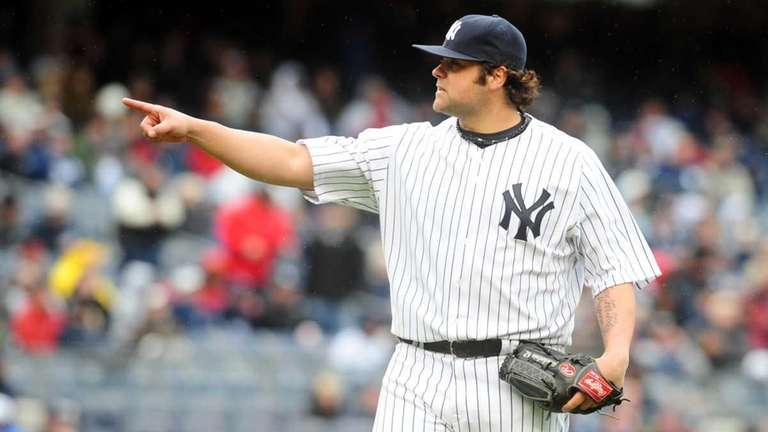Yankees reliever Joba Chamberlain points while on the