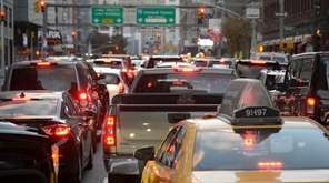 Traffic on Manhattan's Sixth Avenue is at a