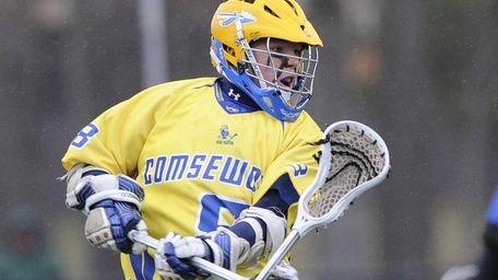 Comsewogue's Matt Cossidente shoots and scores against Hauppauge