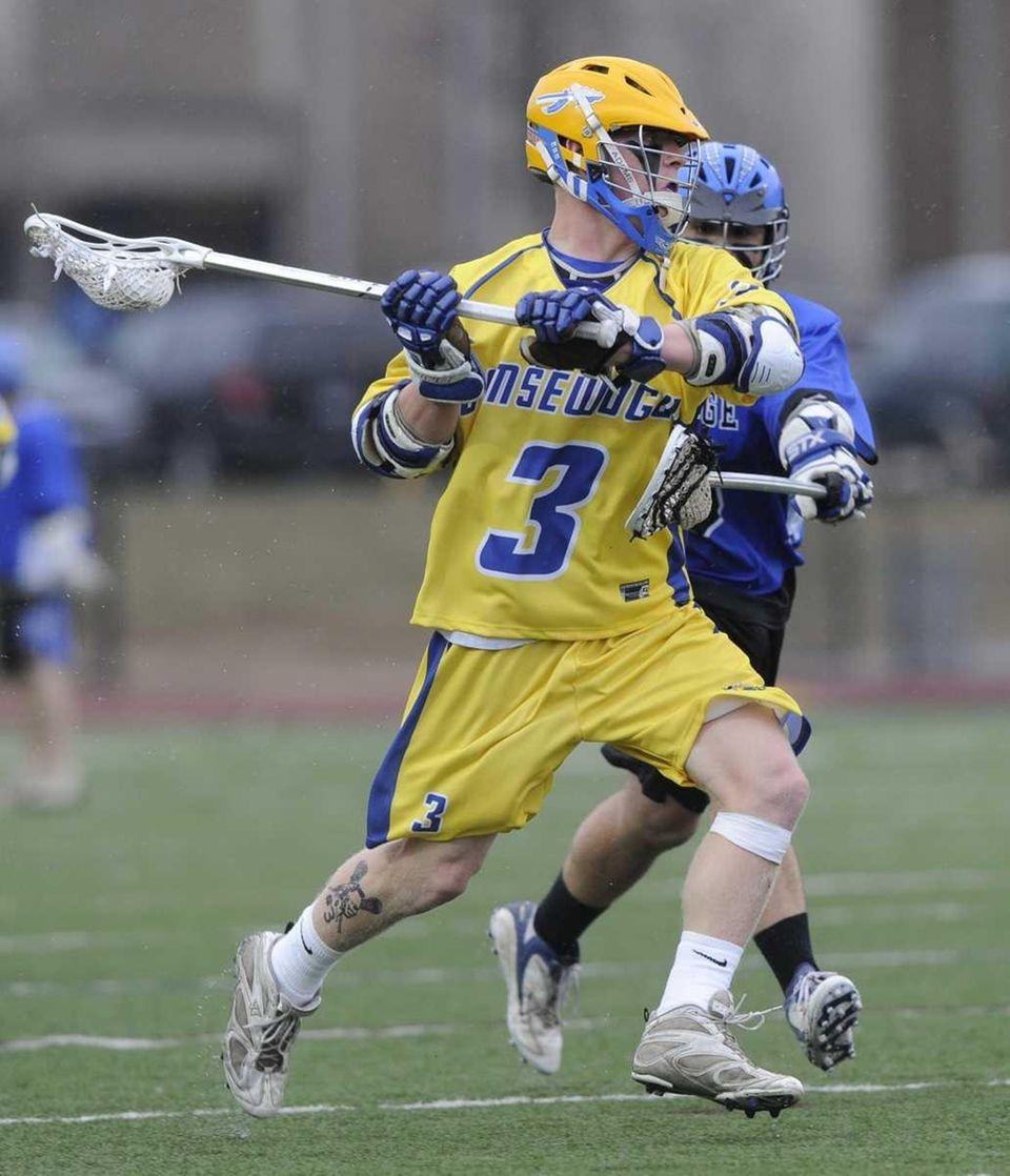Comsewogue's Ryan Brunet winds up to shoot past