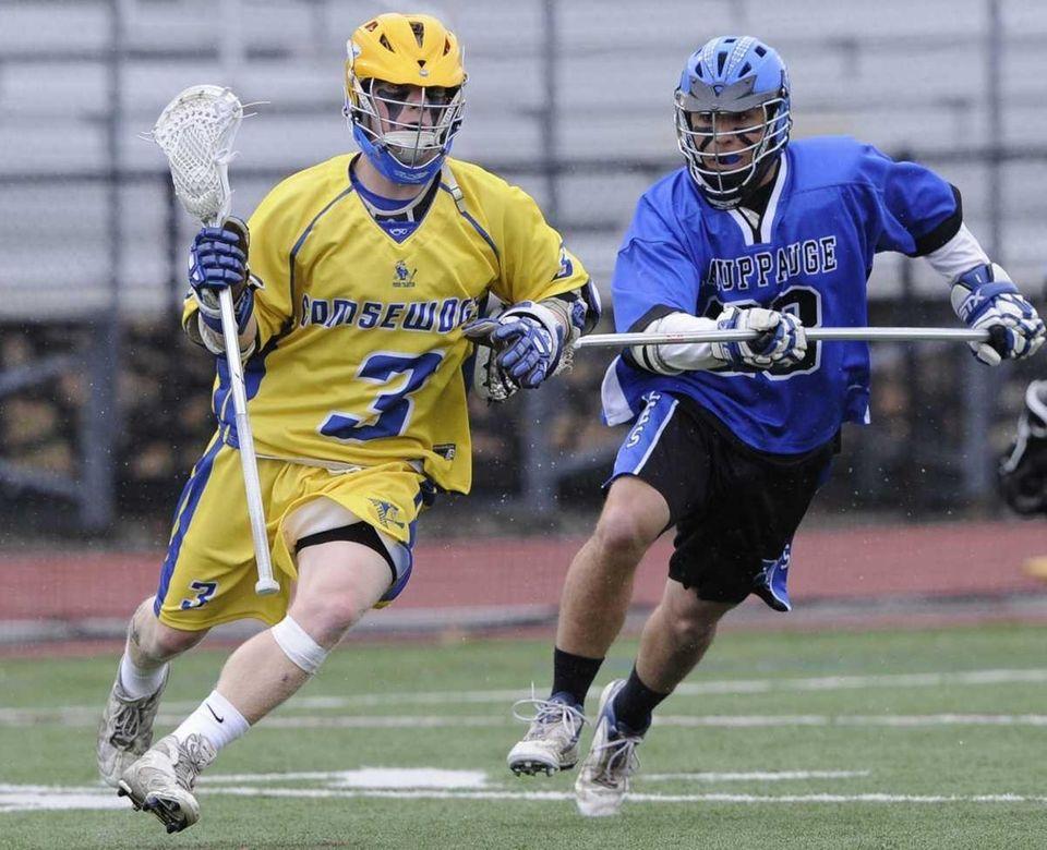Comsewogue's Ryan Brunet is defended by Hauppauge's Joe