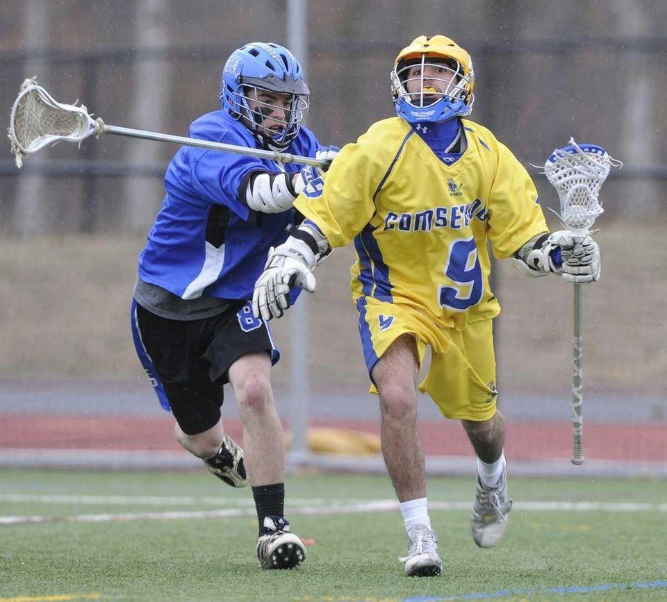 Comsewogue's Tyler Gulizio is defended by Hauppauge's Matt