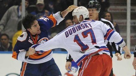 The Islanders' Jack Hillen fights the Rangers' Brandon
