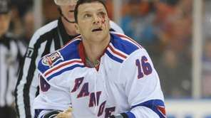 Sean Avery of the ew York Rangers leaves