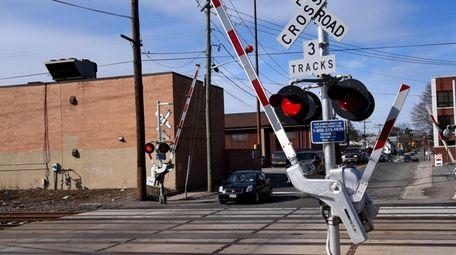 This LIRR grade crossing at School Street in