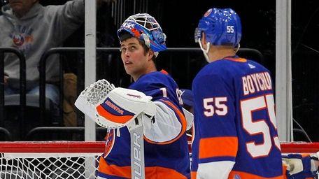 Thomas Greiss and Johnny Boychuk of the Islanders