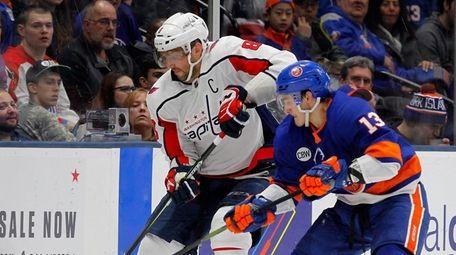 Alex Ovechkin #8 of the Washington Capitals battles