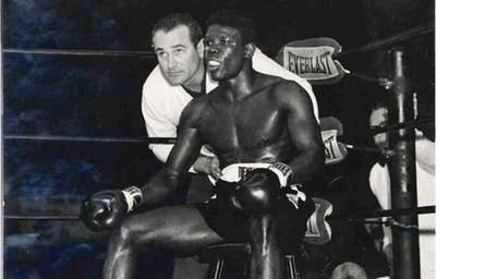 Boxing coach Gil Clancy advises Emile Griffith before