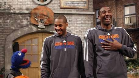 Amar'e Stoudemire, center, and Carmelo Anthony are shown