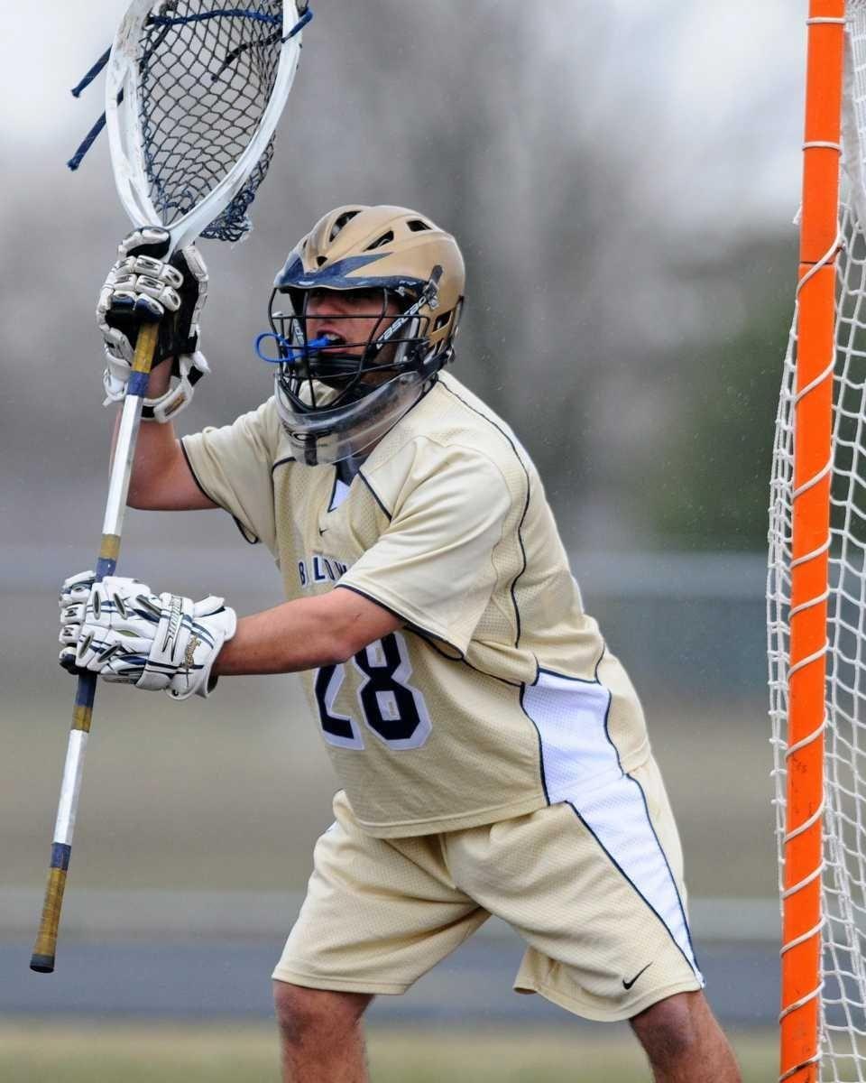Baldwin High School goalkeeper #28 Brett Dadiego defends