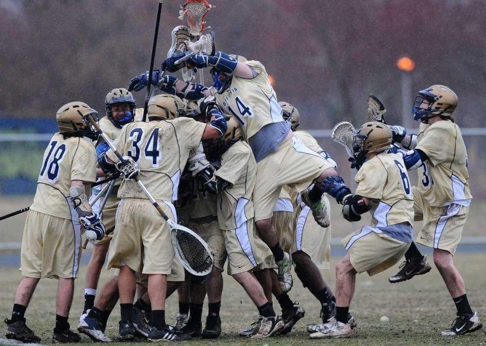 Baldwin High School varsity boys lacrosse teammates mob