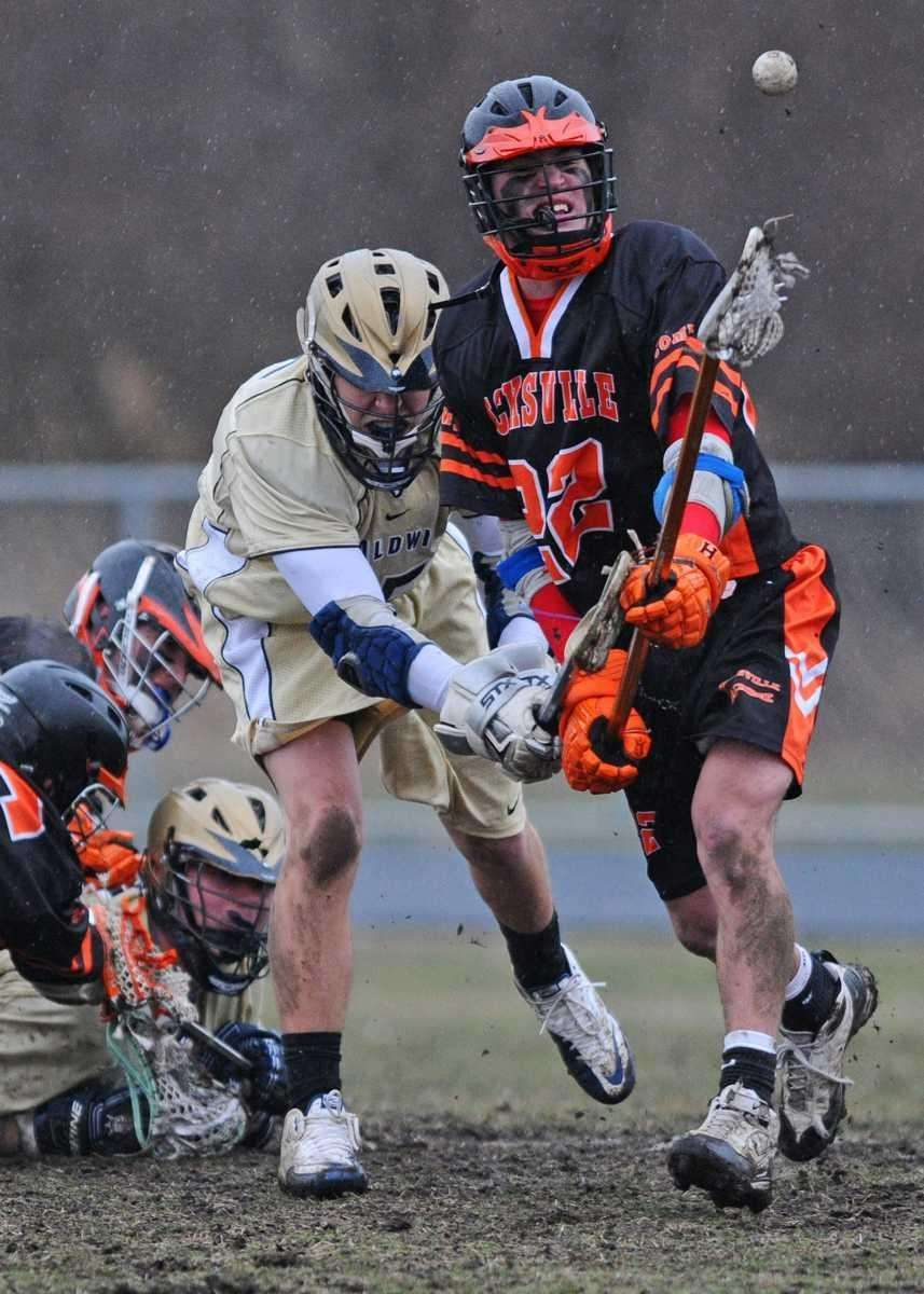Hicksville High School #22 Matt Brendel, right, and
