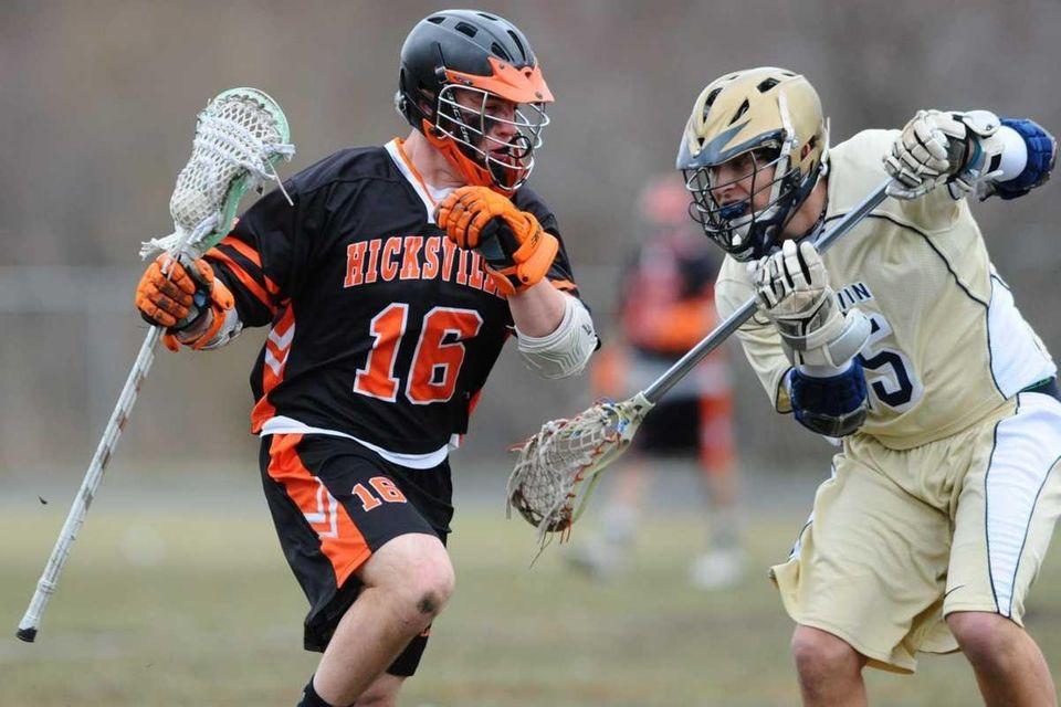 Hicksville High School #16 Ryan Tarzia, left, gets
