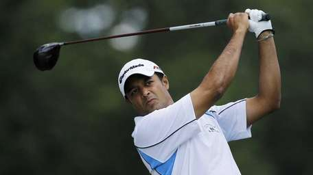 Arjun Atwal, of India, tees off on the