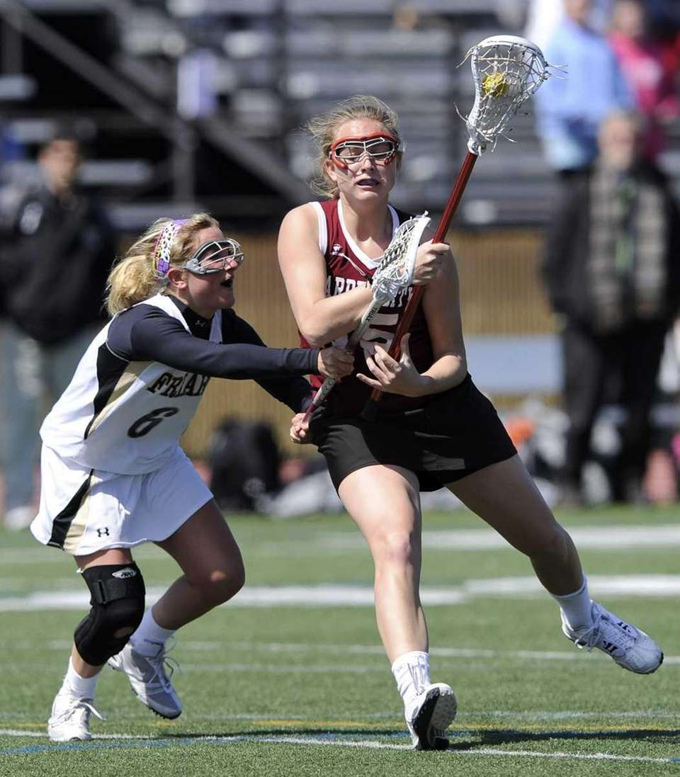 Garden City's Mikaela Rix is defended by St.