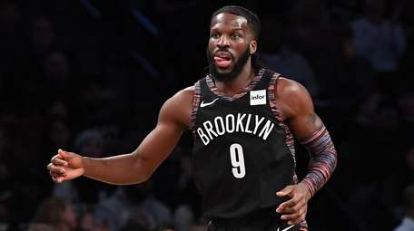Nets forward DeMarre Carroll looks on after sinking