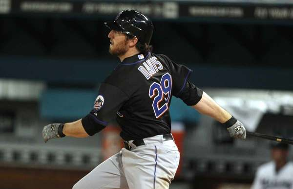 New York Mets' Ike Davis (29) follows through