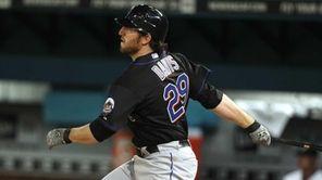 New York Mets' Ike Davis (29) follows through