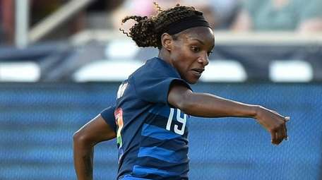 Crystal Dunn of the United States directs the