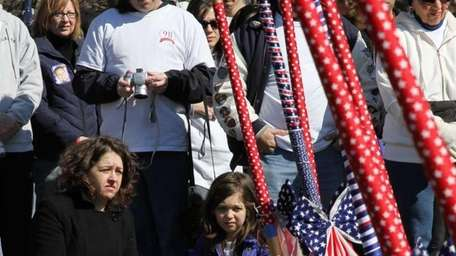 Supporters look on during a groundbreaking ceremony for
