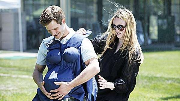 Rosie Pope, right, helps an expecting father feel