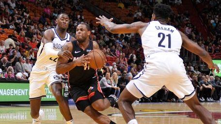 Miami Heat guard Dion Waiters drives past Brooklyn