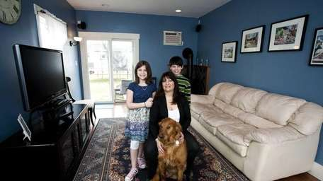Homeowner Diane Koudelka, her children James Jr. and
