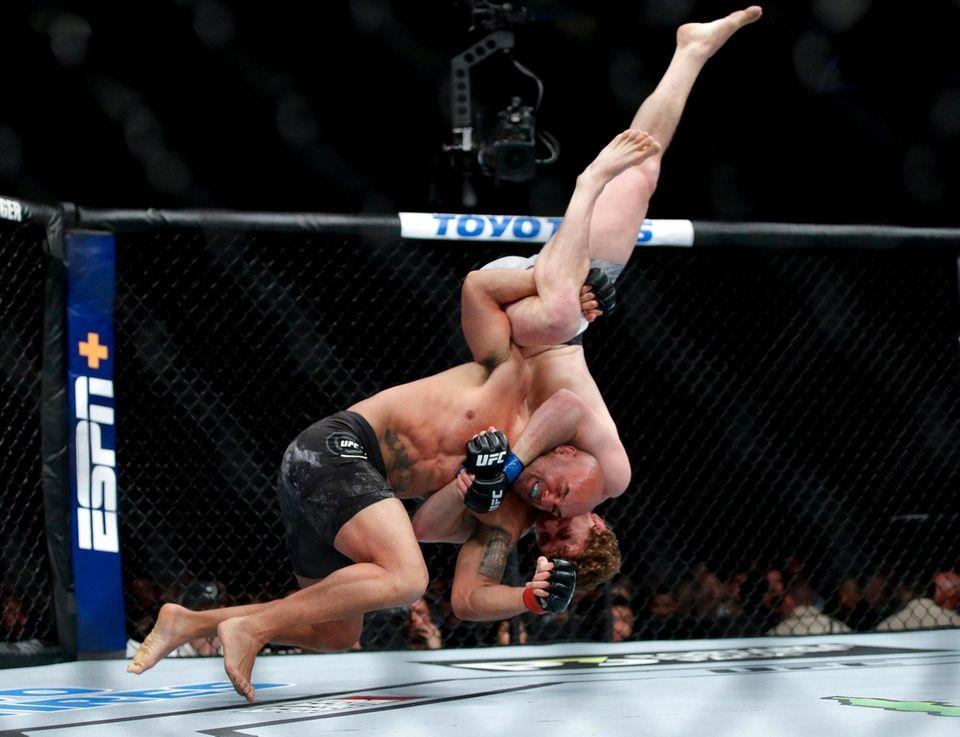 Robbie Lawler, left, fights Ben Askren in a