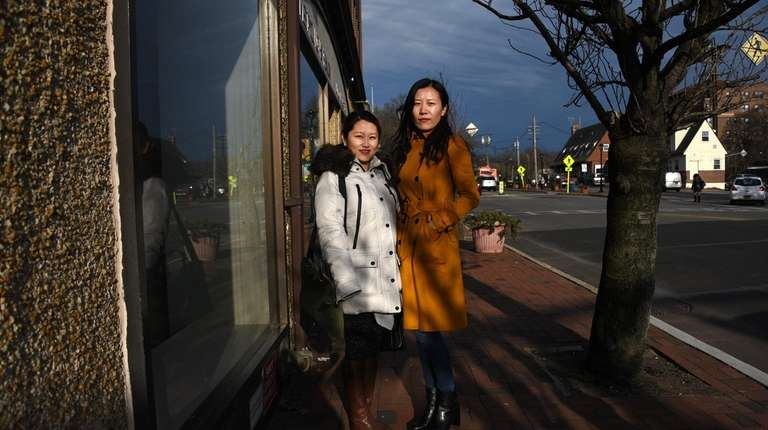 Dorothy Feng, left, and Mandy Xiao, right, both