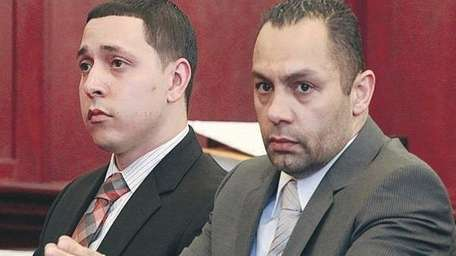 Officers Franklin Mata, right, and Kenneth Moreno