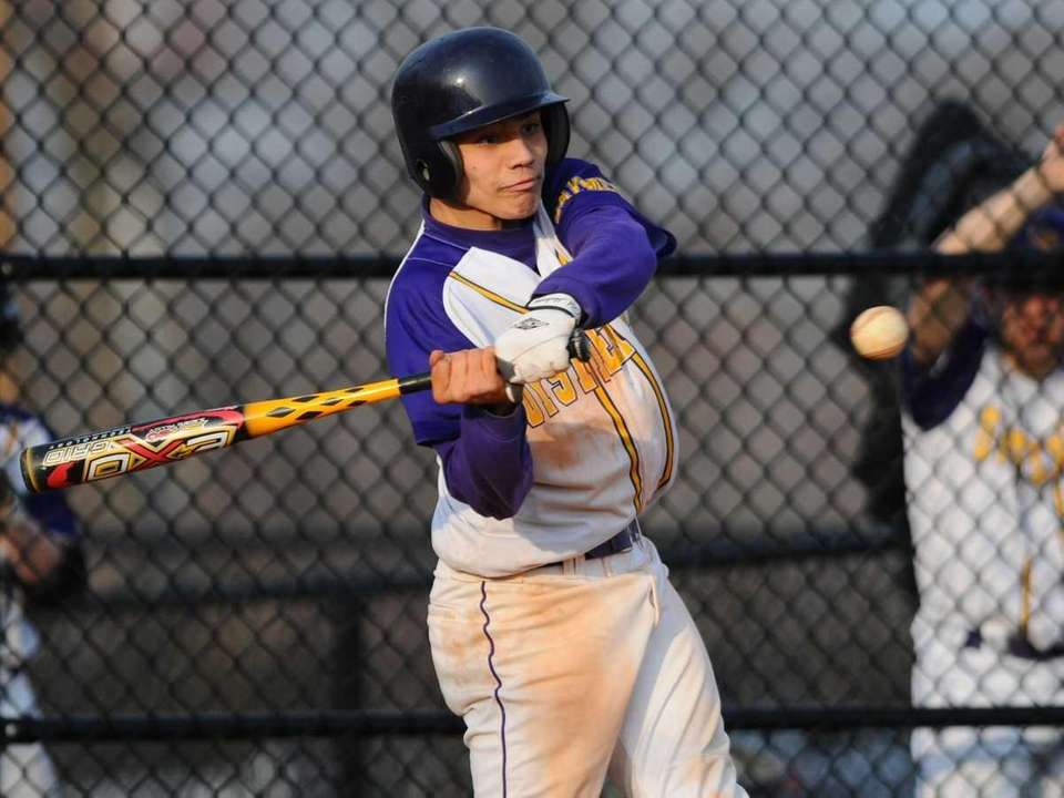 Oyster Bay's Robert Morgan clears the bases with