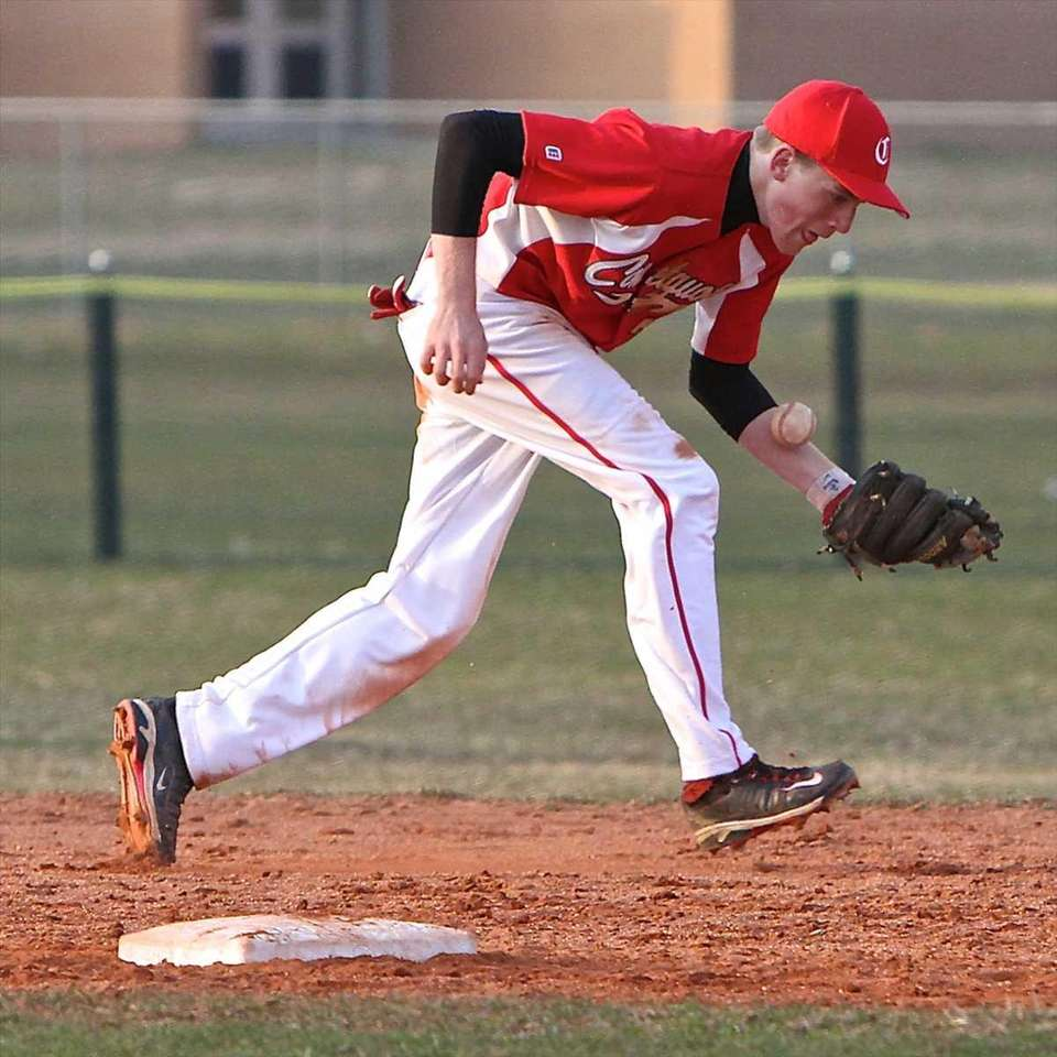 Connetquot shortstop Casey Baker tries to get a