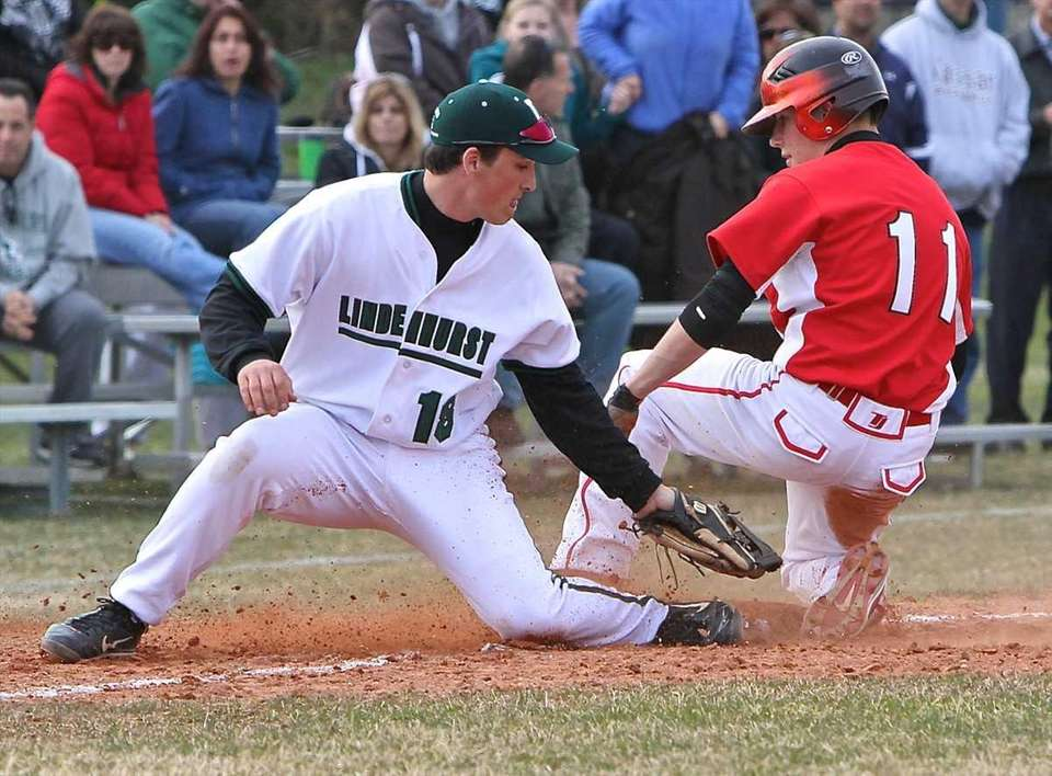 Connetquot's Brian McKean, right, is safe at third