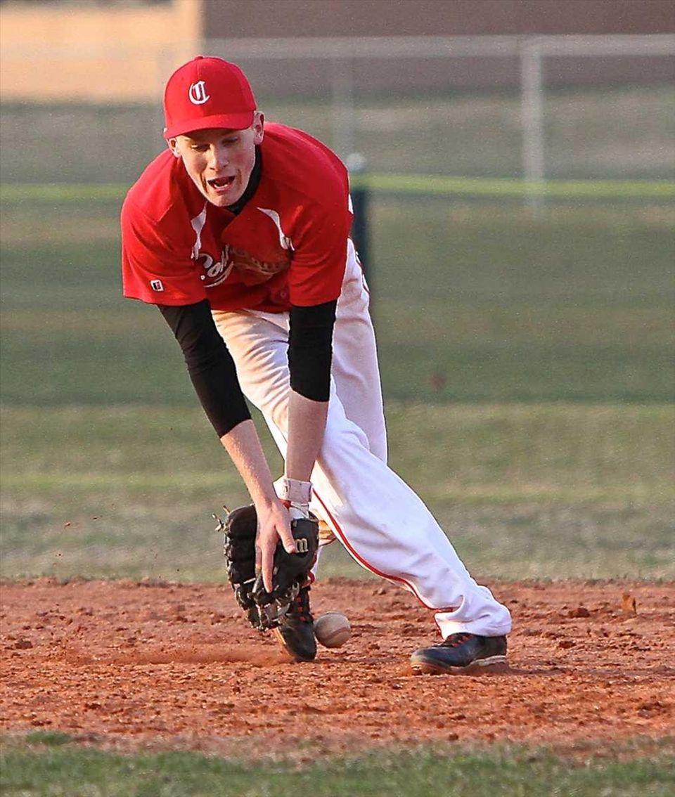Connetquot shortstop Casey Baker can't get a handle