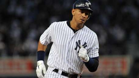 Yankees third baseman Alex Rodriguez rounds second base