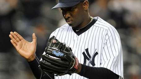 Yankees relief pitcher Rafael Soriano reacts after getting