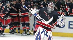 Rangers goalie Henrik Lundqvist celebrates as he skates