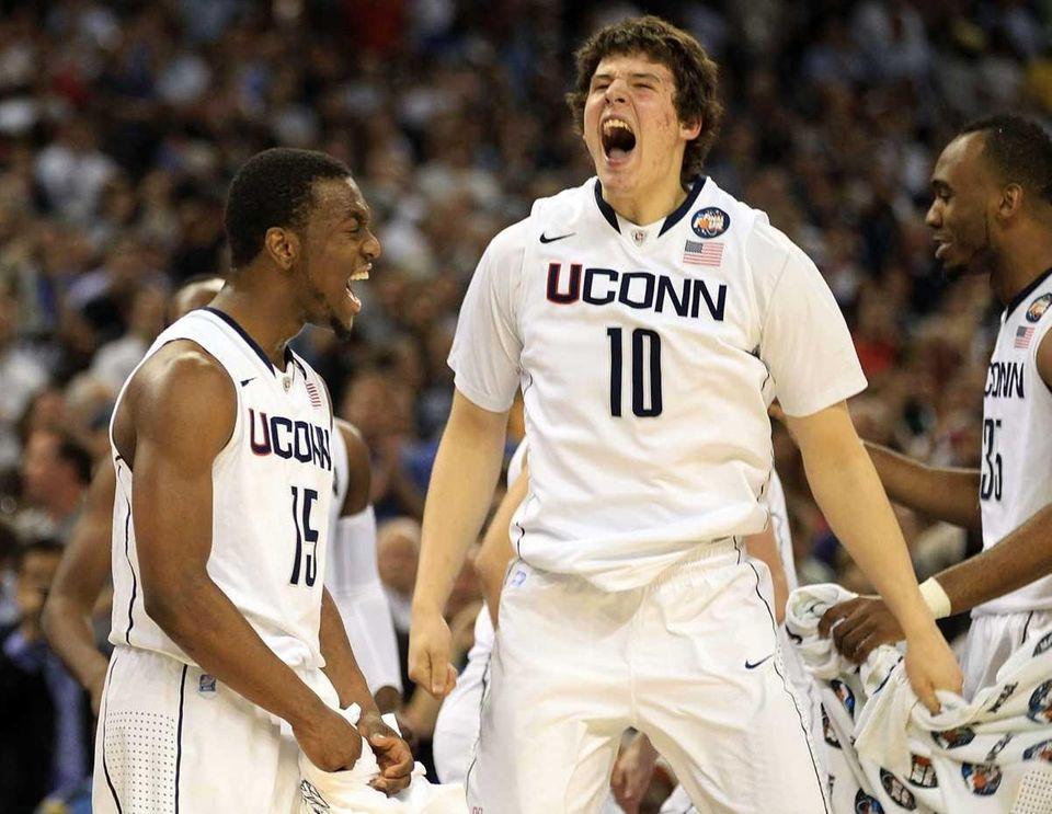 UConn's Kemba Walker, left, and Tyler Olander react