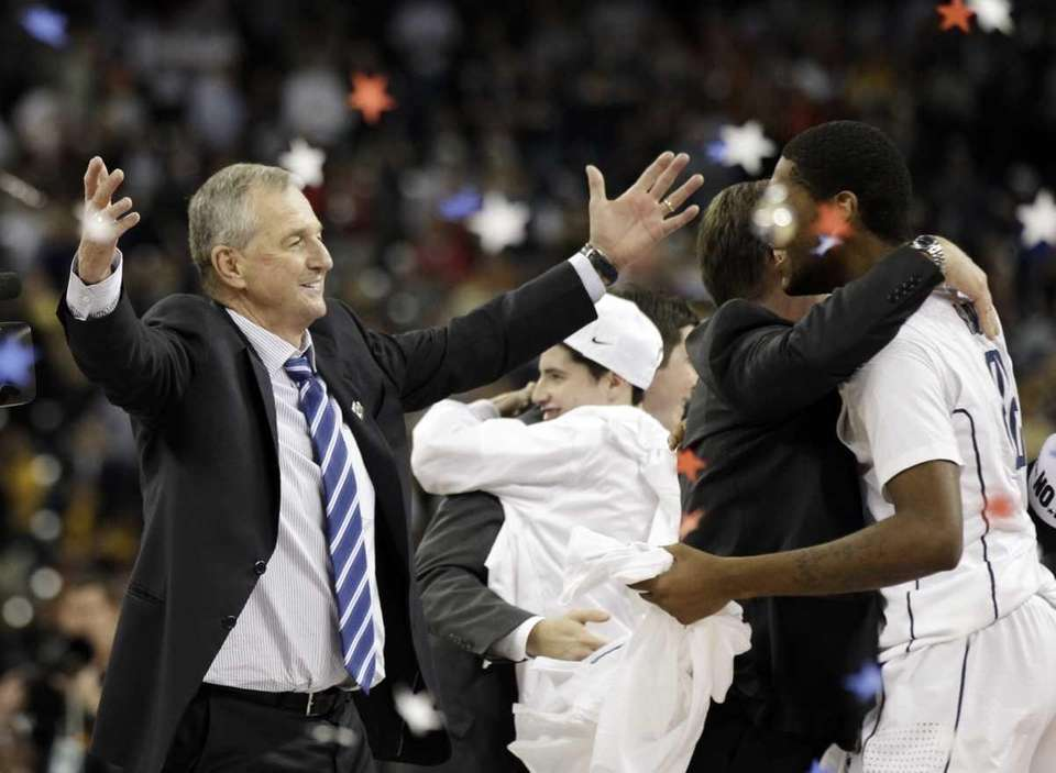 Connecticut head coach Jim Calhoun celebrates after his