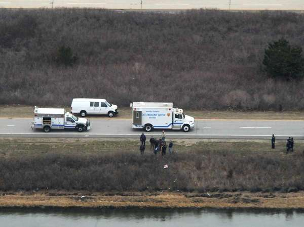 Police examine the area between Oak Beach and