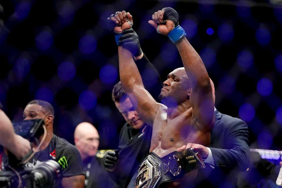 Kamaru Usman celebrates after his win against Tyron