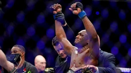 Kamaru Usman celebrates after his win against Tyron